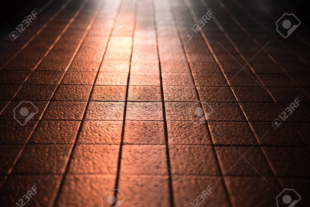 Abstract Of Sunlight Reflect On Clay Tile Floor In Corridoor Stock