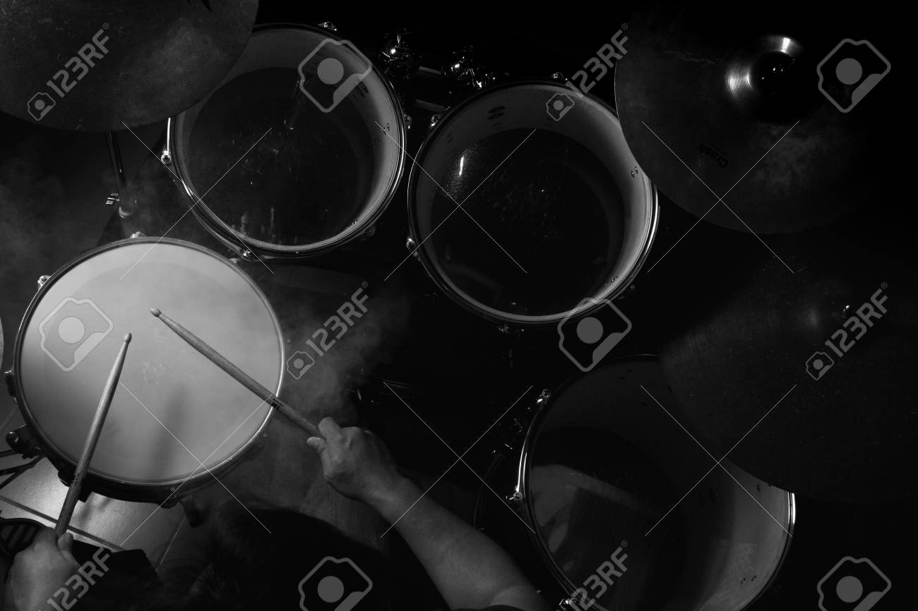 Stock photo the man is playing drum set in low light background black and white