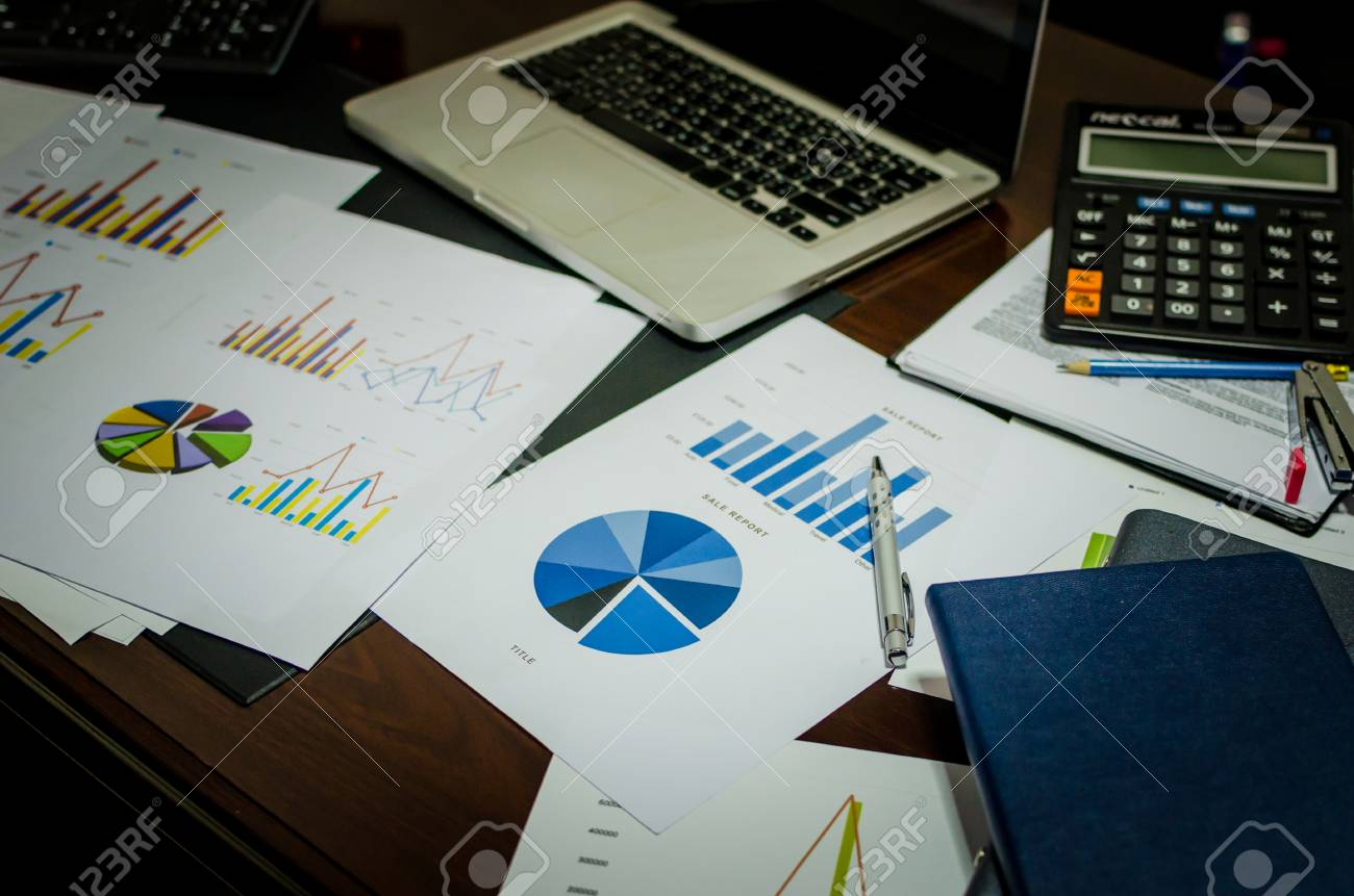 Documents on office table with laptop computer and graph financial documents on office table with laptop computer and graph financial with social network diagram filter ccuart Choice Image