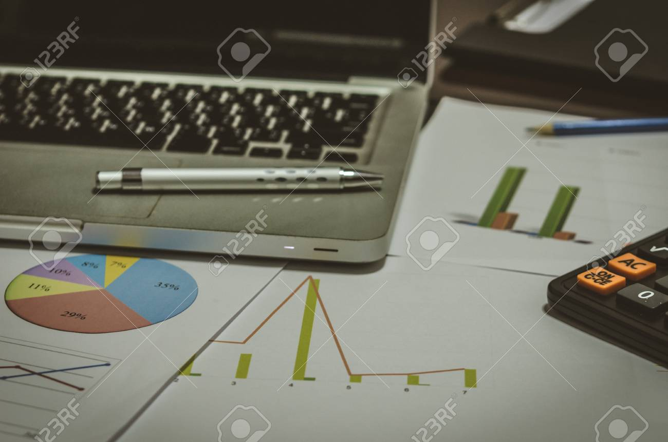 Documents on office table with laptop computer and graph financial documents on office table with laptop computer and graph financial with social network diagram filter ccuart Image collections