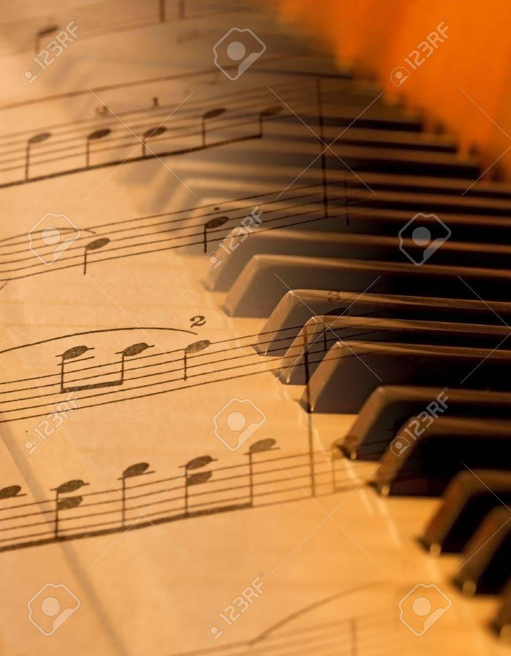 Sheet music blended over piano in soft light blurred Stock Photo - 9834690
