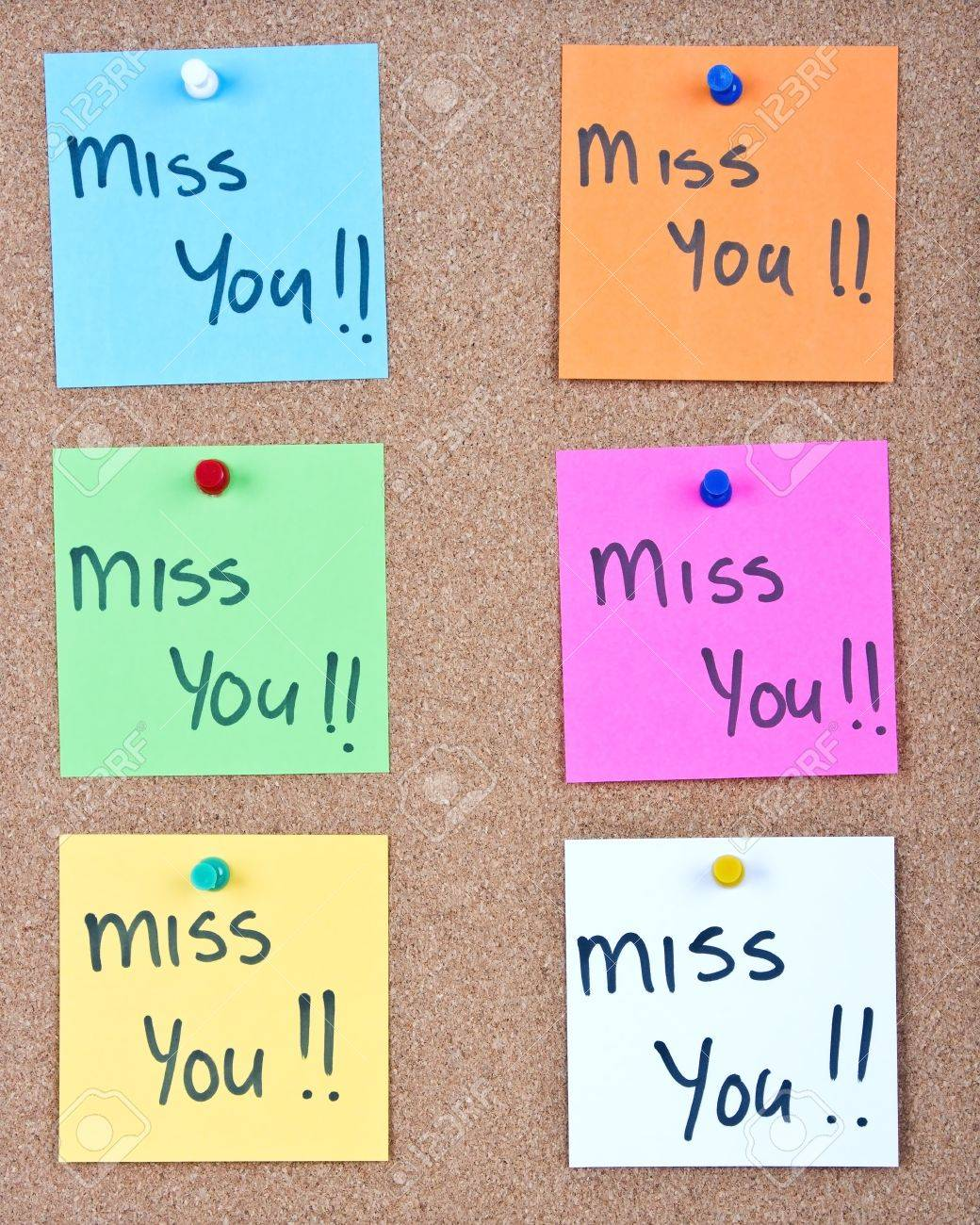 Post it note collage with miss you messages on cork