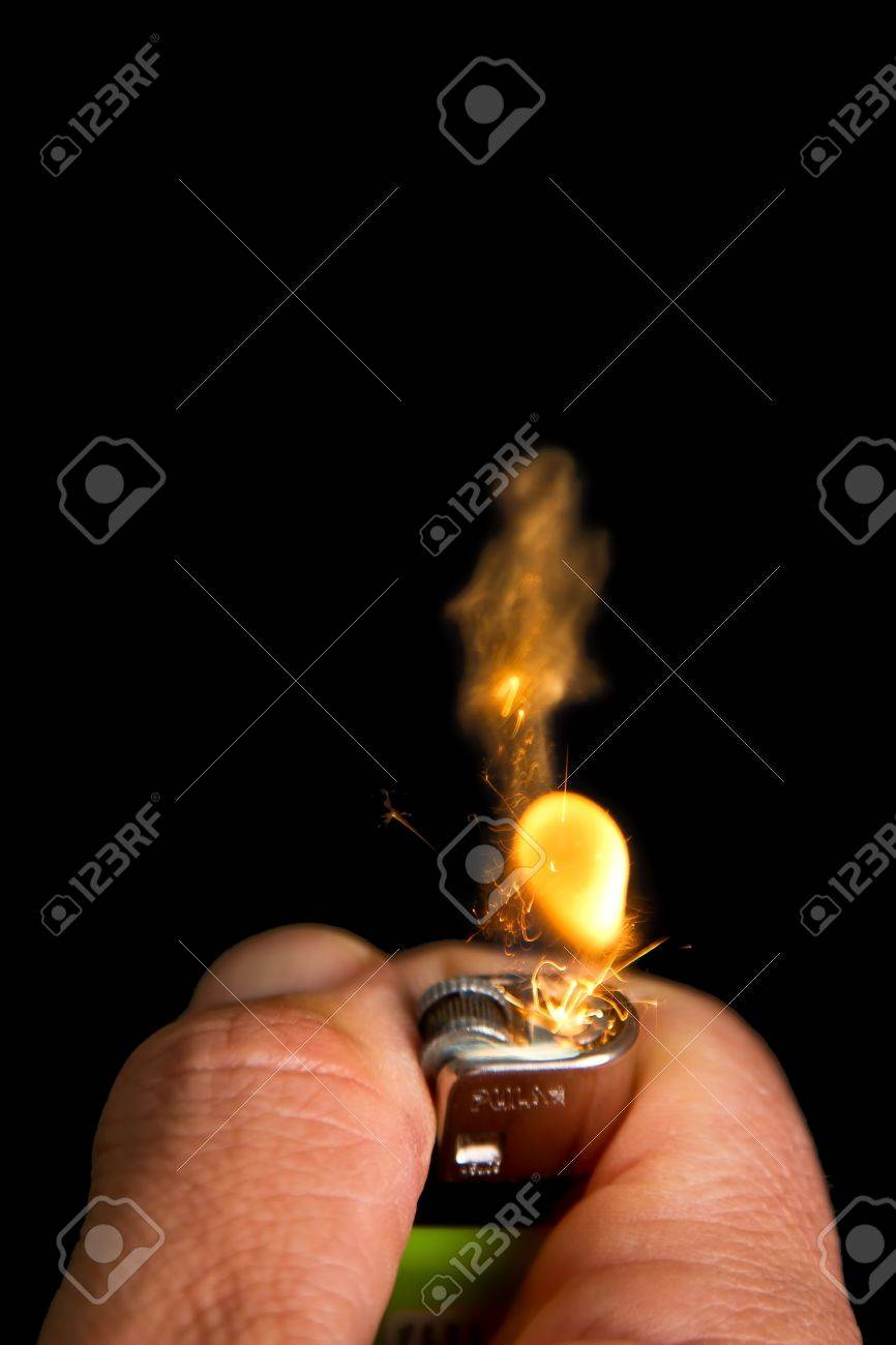 Hand with lighter igniting sparks close-up on dark background Stock Photo - 21709786