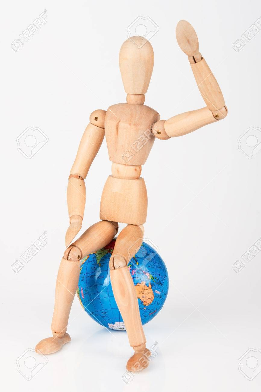 Wood Mannequin Sitting On Top Of A World Globe To Protect Isolated
