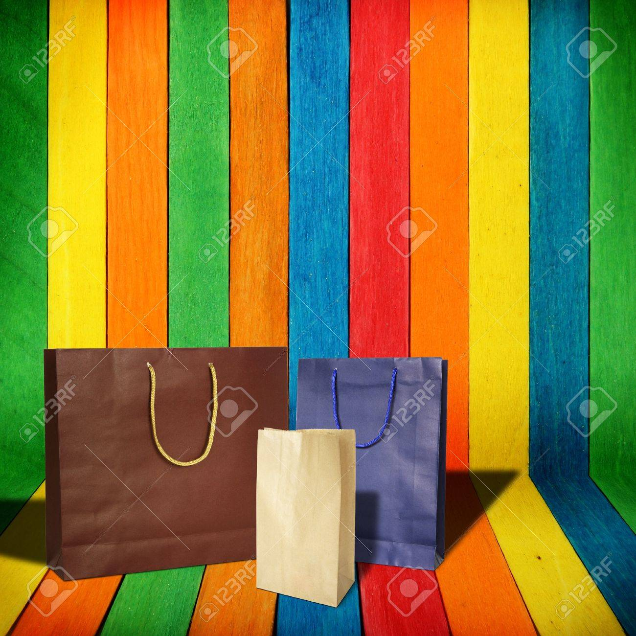 Shopping Bags On Colorful Wood Background Stock Photo, Picture And ...
