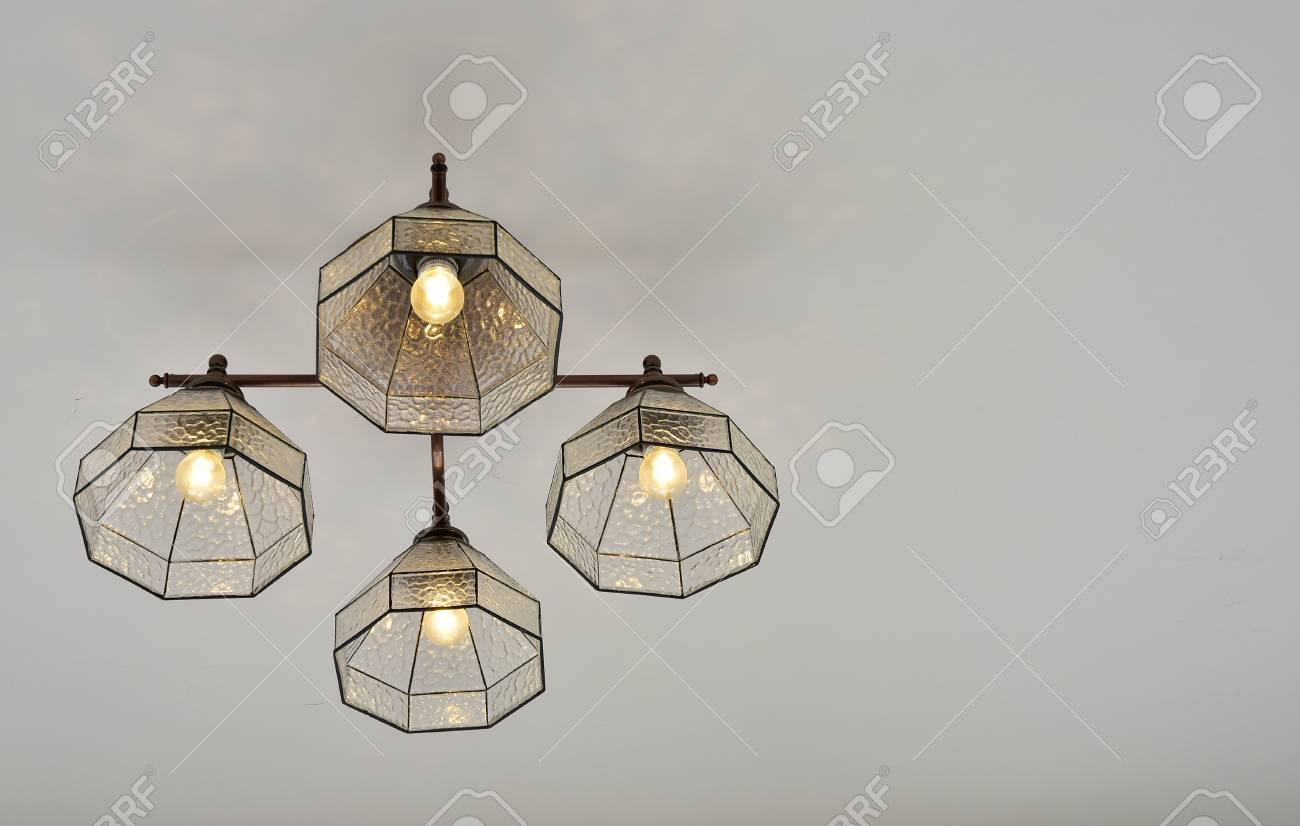 Lighting fixtures suspended from the ceiling of the room stock photo 107272136