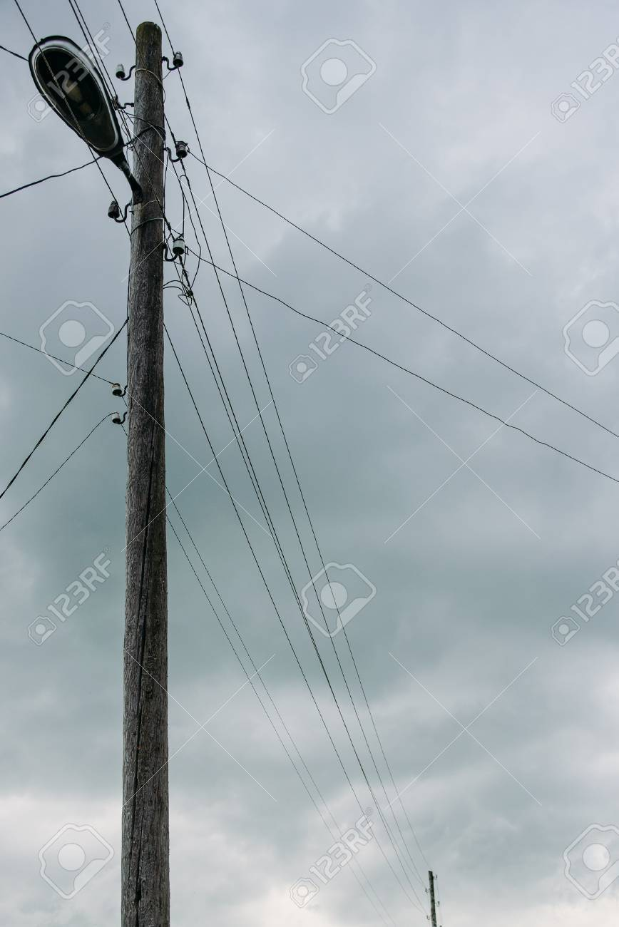 Village Wooden Street Lamp Post With Lantern And Wires On Clouds ...