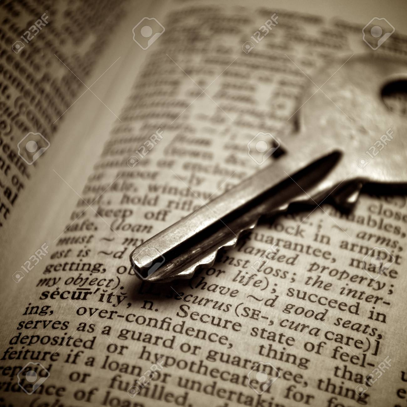 Security definition pointed out by key Stock Photo - 10298348
