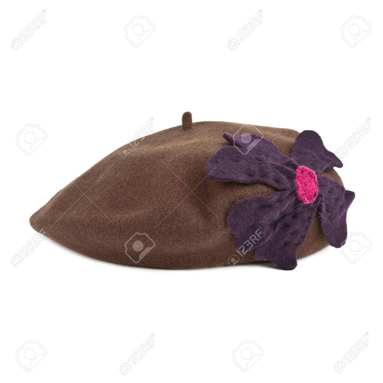 6a75324200f95 pink french beret made from felt with floral motive on white background  Stock Photo - 79416798