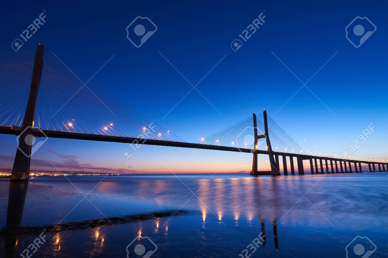 Long exposure shot of Vasco da Gama bridge in Lisbon before sunrise - 136073381