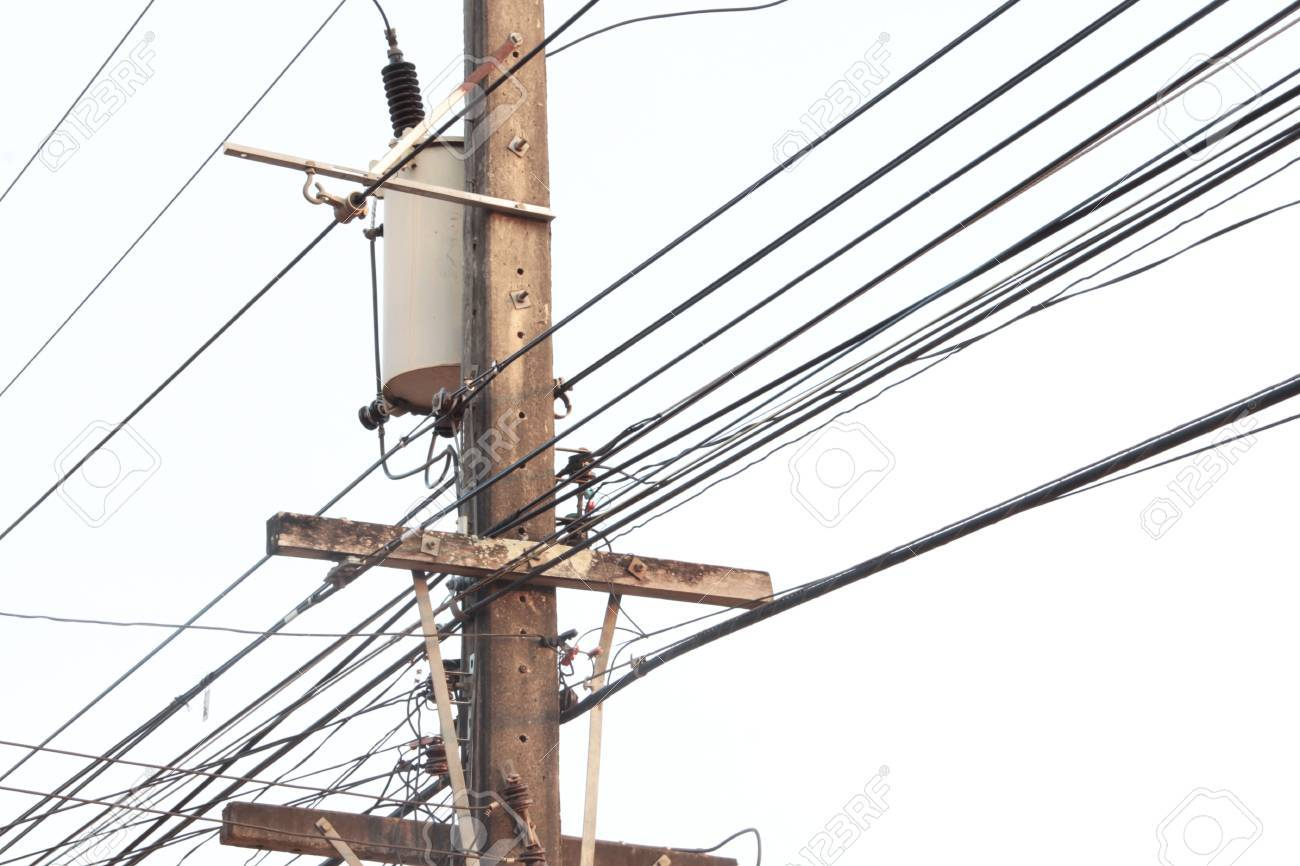 Electric Pole Connect To The High Voltage Electric Wires On Blue ...