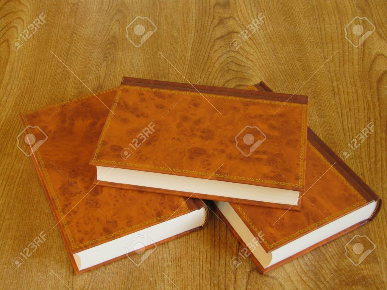 a display of three hard covered books stock photo picture and