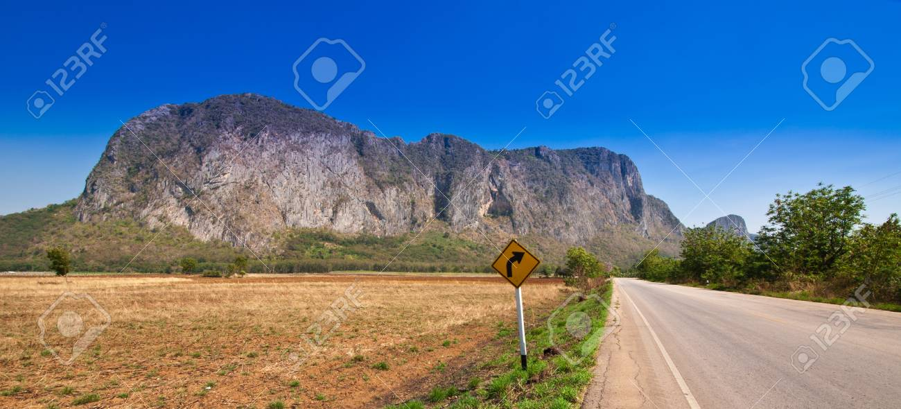 View of rural road and blue sky at Sa Kaeo Province, Thailand Stock Photo - 12445672