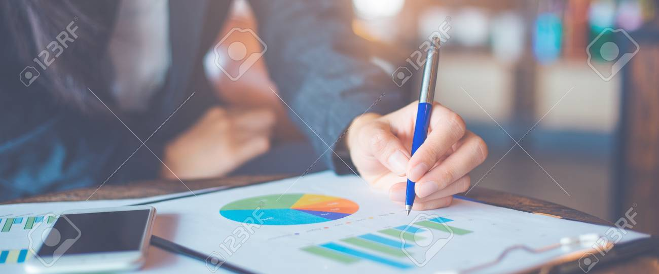 Business woman hand writing on charts and graphs that show results.Web banner. - 111411982