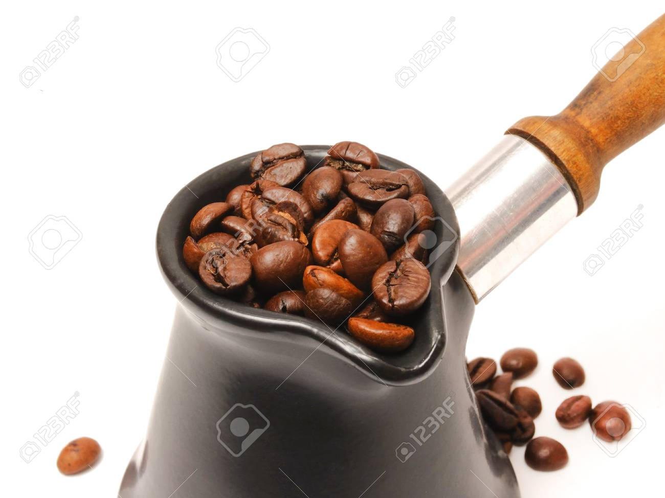 Coffee in a turk with coffee beans background Stock Photo - 9553530