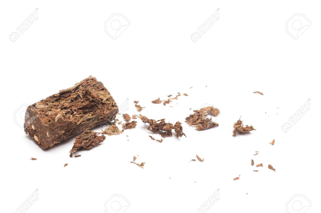 Compacted dried marijuana isolated over white background. - 148297447