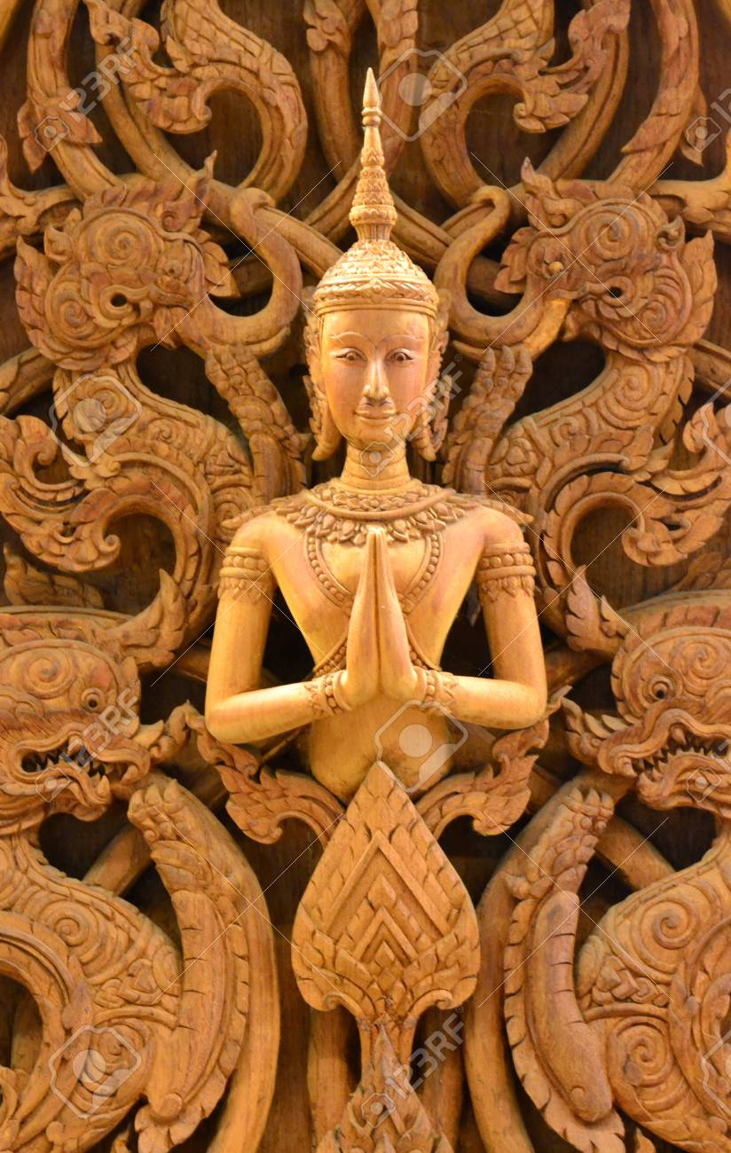 An ancient mural wood carving in Thai temple. Stock Photo - 18223797