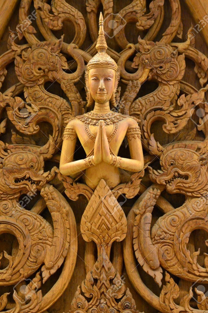 Tranh Gỗ Đồng Quê Việt Nam, Thái Lan Và Nhiều Loại Khác 18223796-an-ancient-mural-wood-carving-in-thai-temple-