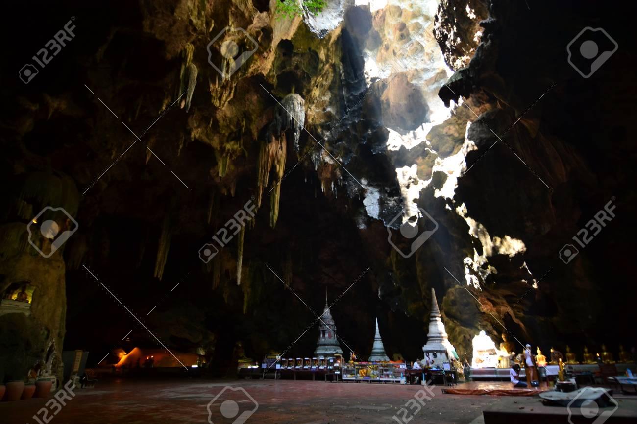 Buddha statue and Natural light inside the cave at Khaoluang, Phetchaburi Province, Thailand. Stock Photo - 18565319