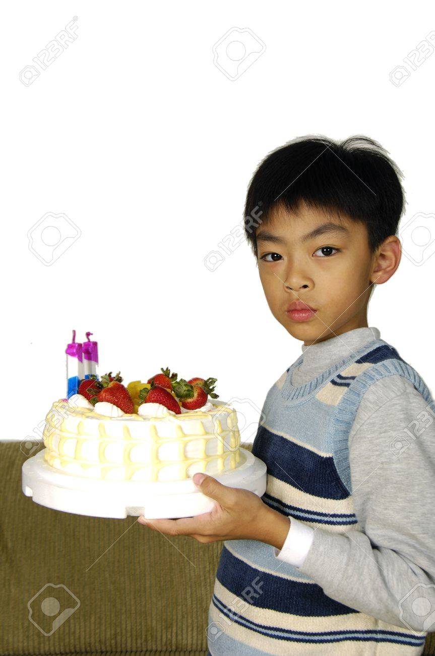 Young Boy Holding Birthday Cake Stock Photo Picture And Royalty