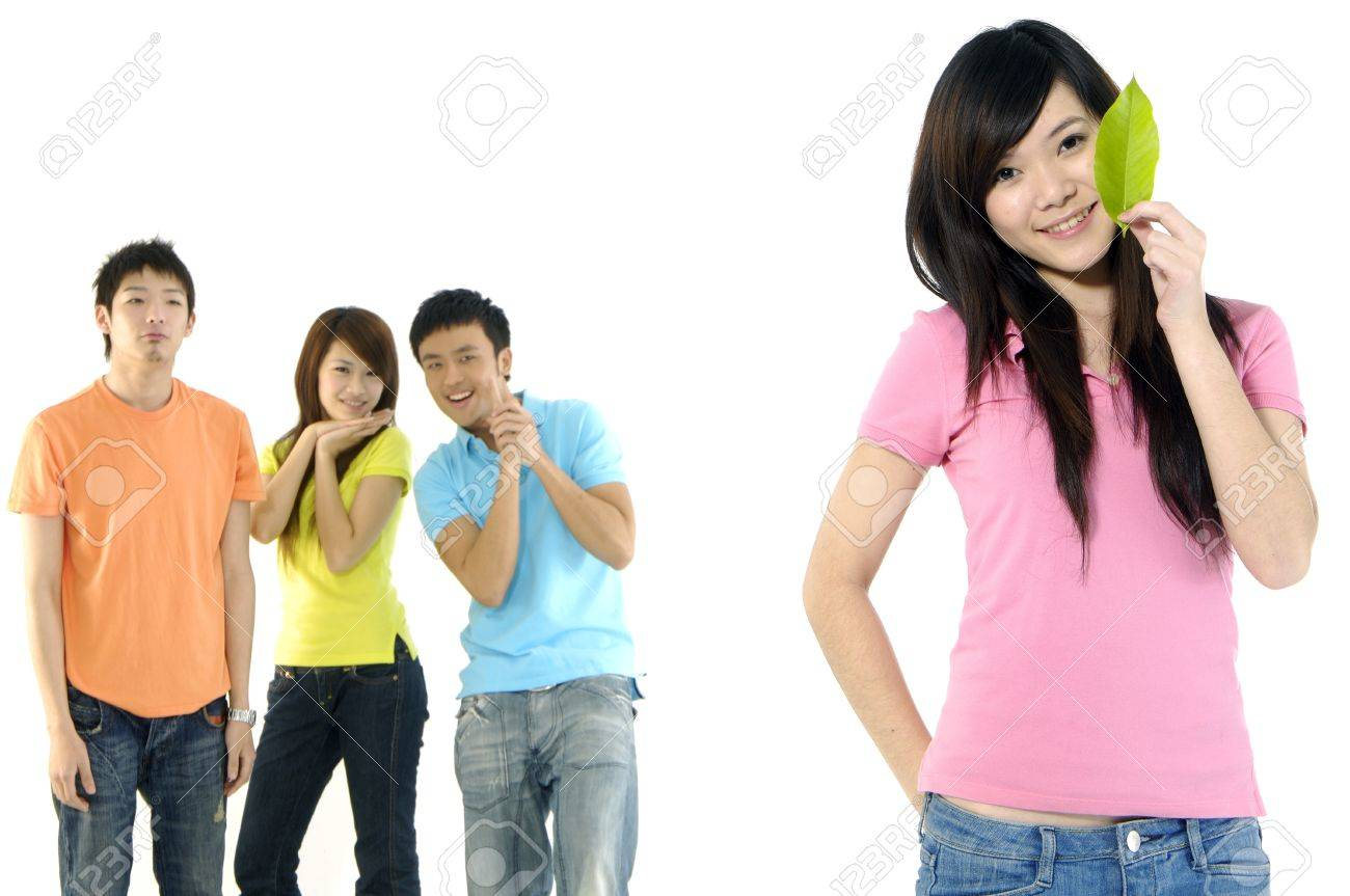 Asian group of happy friends –focus on girl holding leaf Stock Photo - 11080007