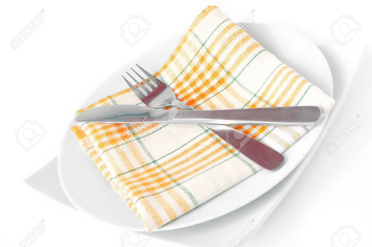 Napkin, folded on a plate with knife and fork c isolated Stock Photo - 8257539