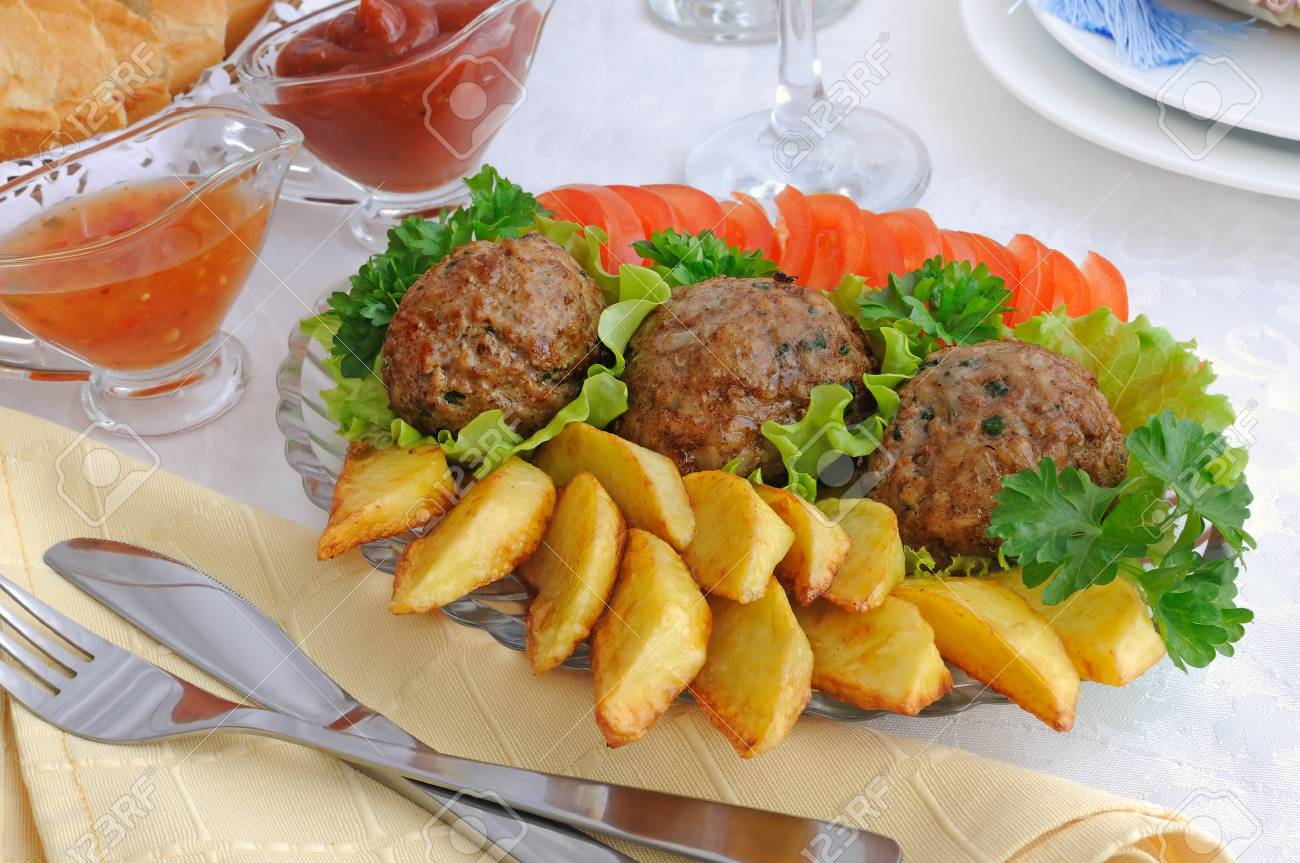 Meatballs with greens on salad leaves with potatoes and tomatoes Stock Photo - 13323763
