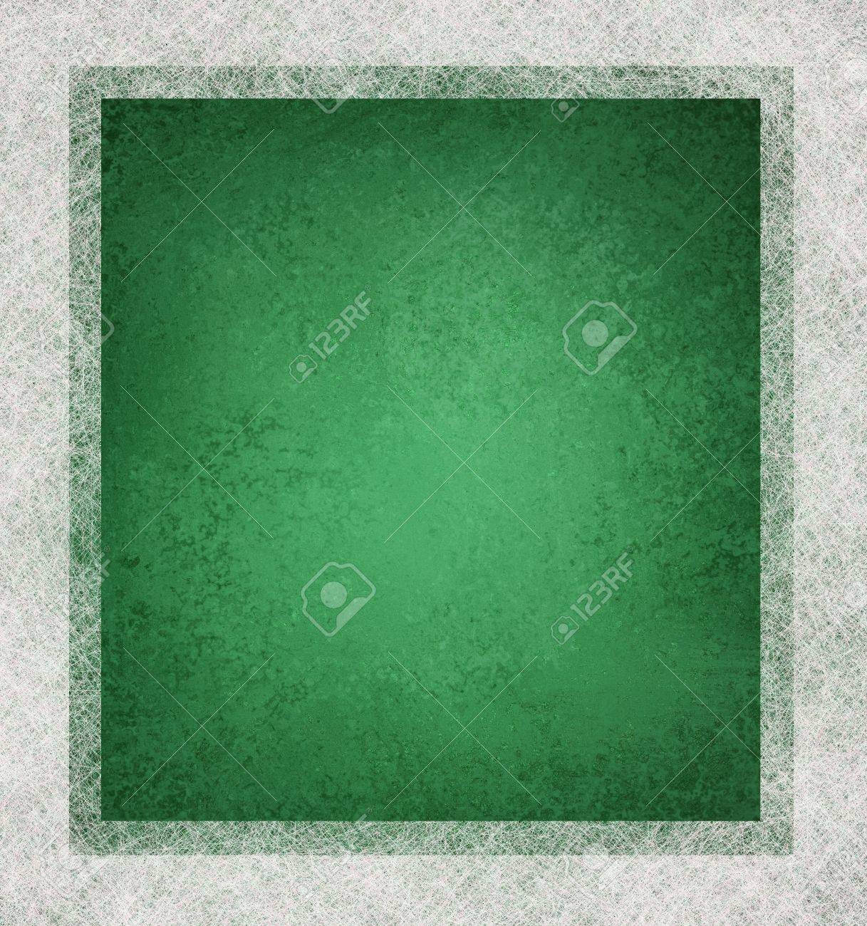 green background with white parchment frame on border with vintage grunge texture and faded soft lighting with copyspace Stock Photo - 12624018