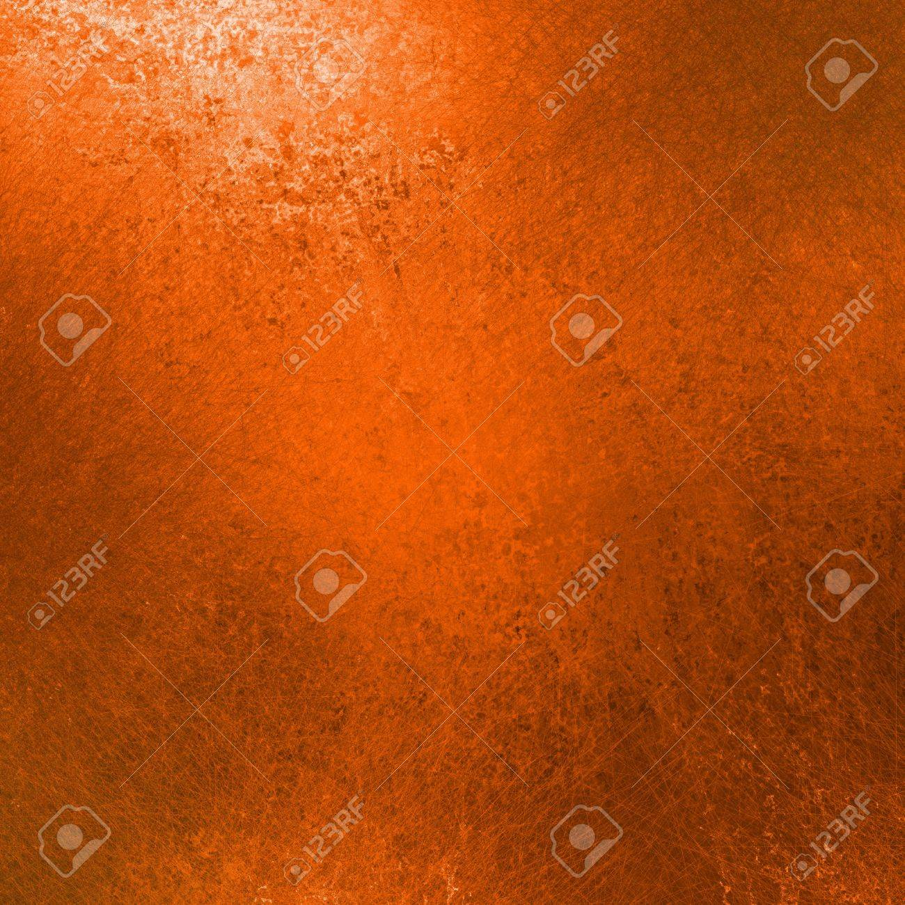 orange background with black vintage grunge texture and white corner highlight for thanksgiving or halloween backgrounds or fall and autumn seasonal backdrops Stock Photo - 13143358