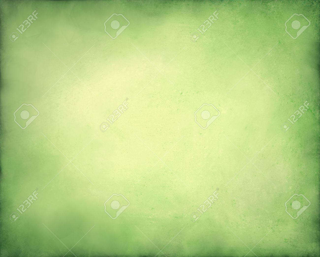 pale abstract green background with yellow center and soft pastel vintage grunge background texture design on border, light green paper page, old abstract background Christmas design Stock Photo - 13659700
