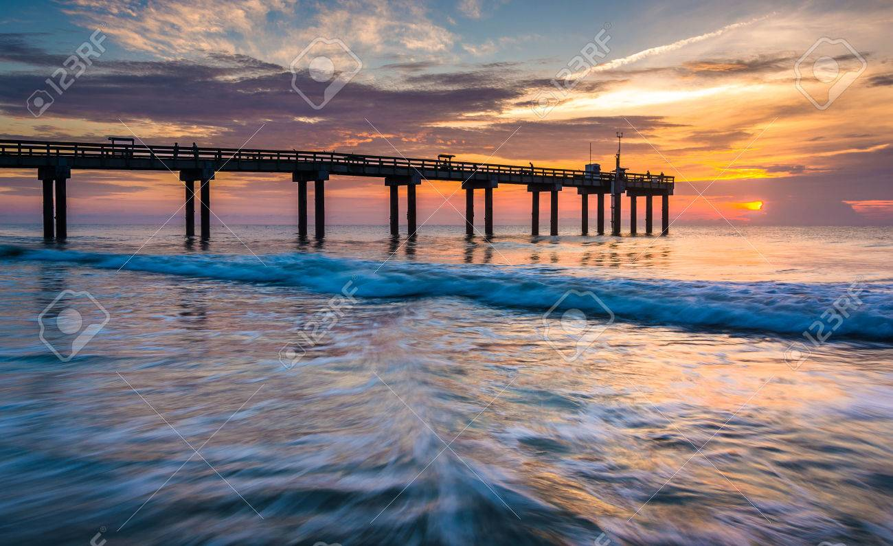 Waves on the Atlantic Ocean and fishing pier at sunrise, St. Augustine Beach, Florida. - 30059402