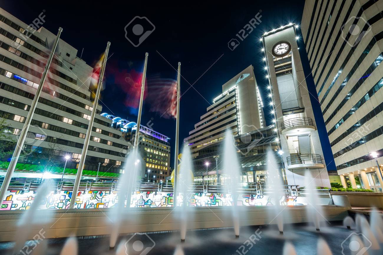 Fountains and modern buildings at night, in downtown Bethesda,