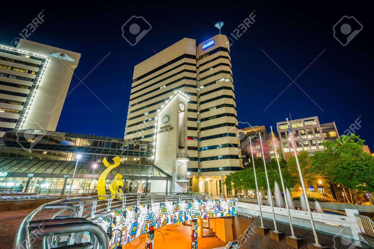 Modern buildings and metro station at night, in downtown Bethesda,