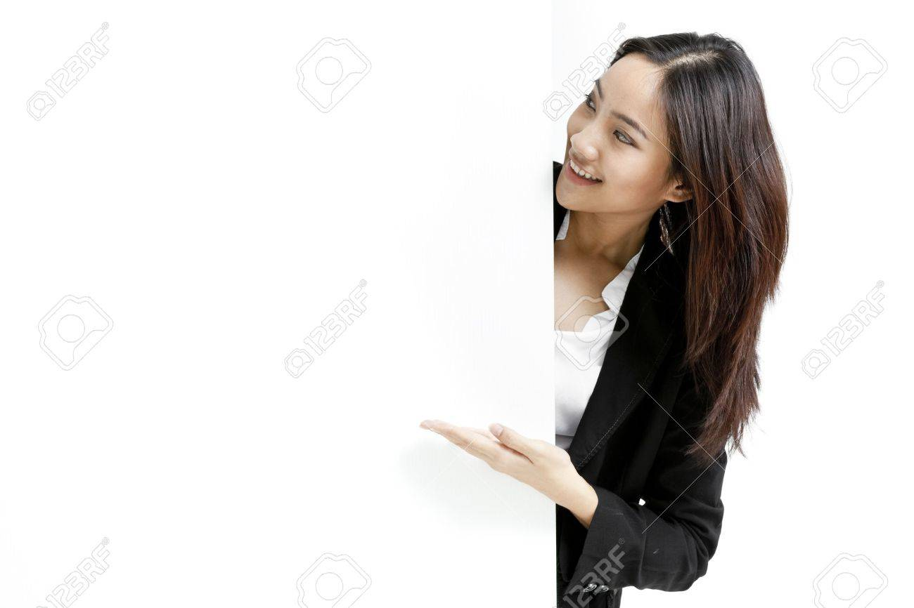 Young business woman posing next to a blank banner isolated on white background Stock Photo - 22304874