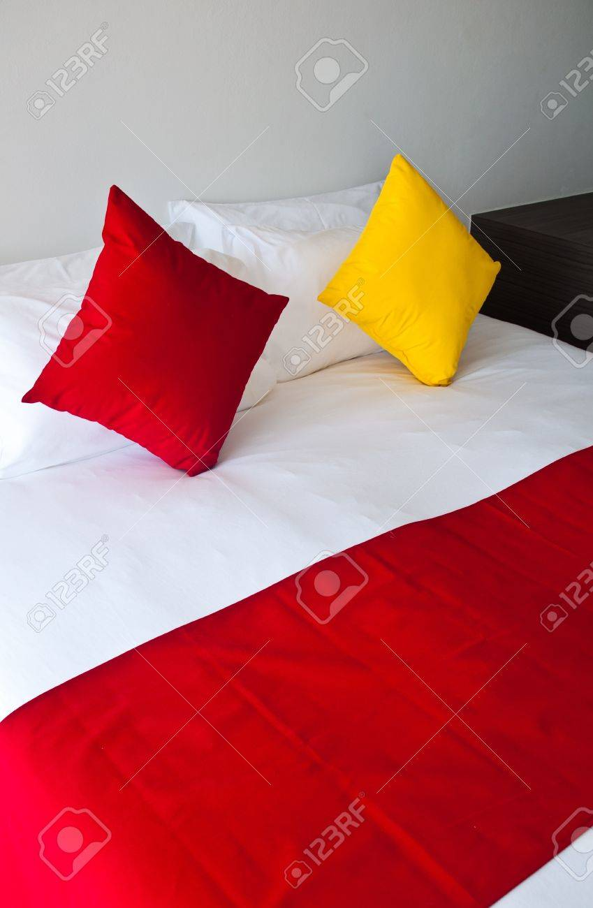 Red And Yellow Pillows On White Bed Stock Photo Picture And Royalty Free Image Image 11154640