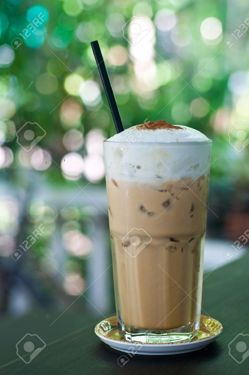 glass of ice coffee on table with bokeh background Stock Photo - 11814430
