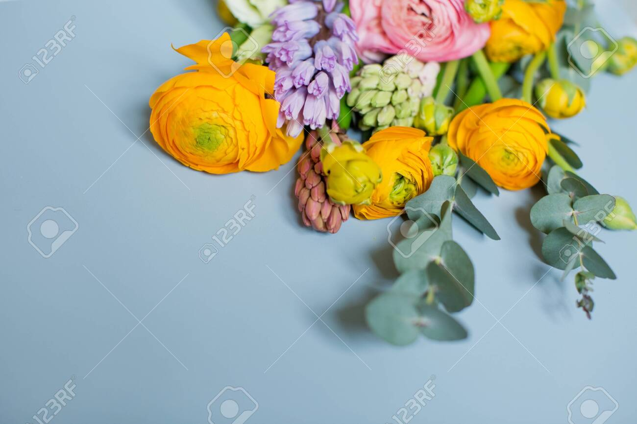 Beautiful Bouquet With Orange And Pink Ranunculus Flowers Eucalyptus Stock Photo Picture And Royalty Free Image Image 153441341