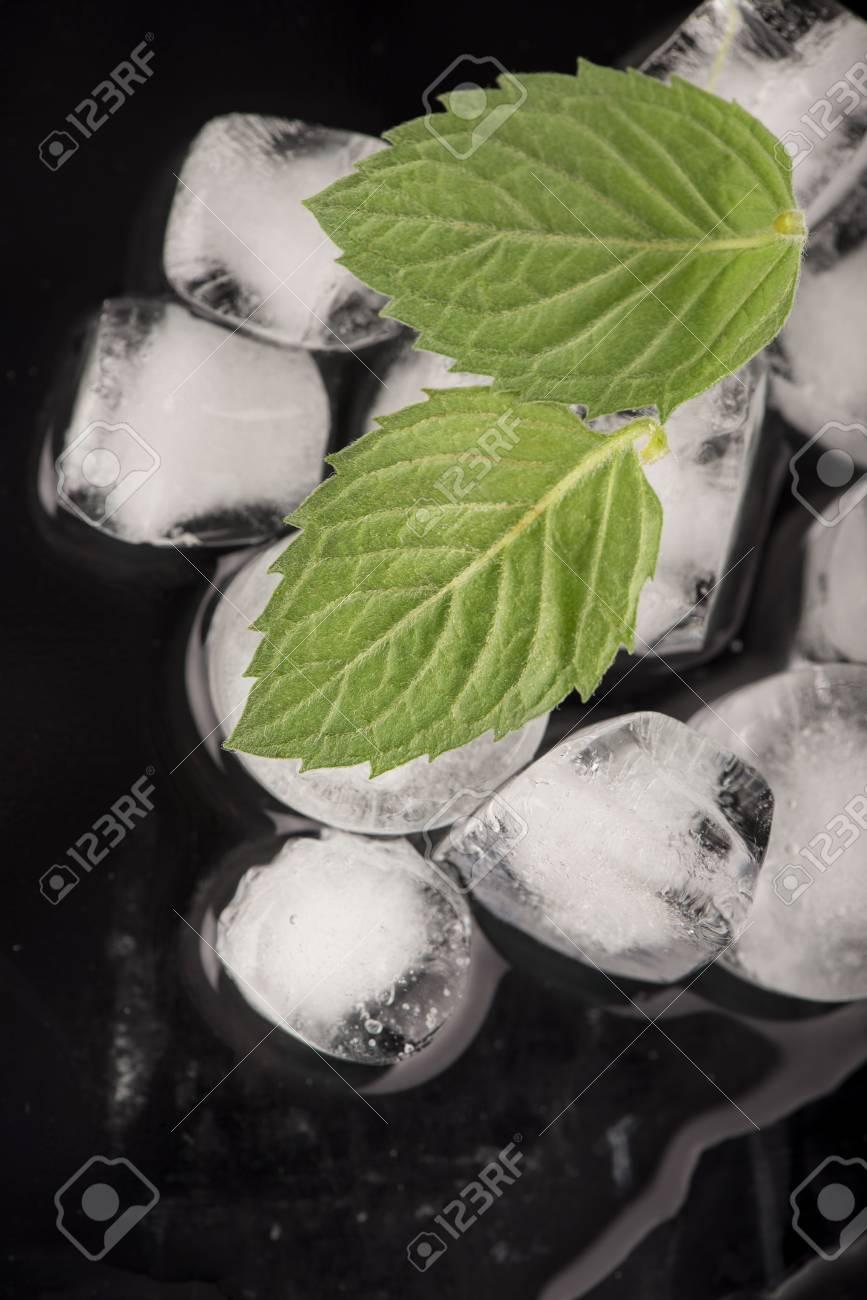 ice cubes, mint leaf on black Stock Photo - 26415974