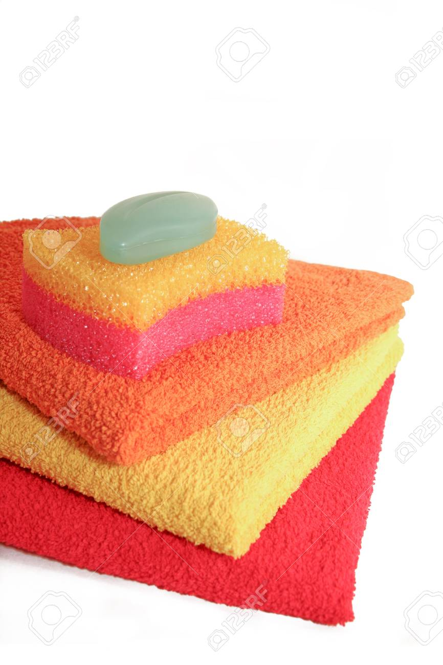 Three towels, bast and soap on a white background Stock Photo - 7035046