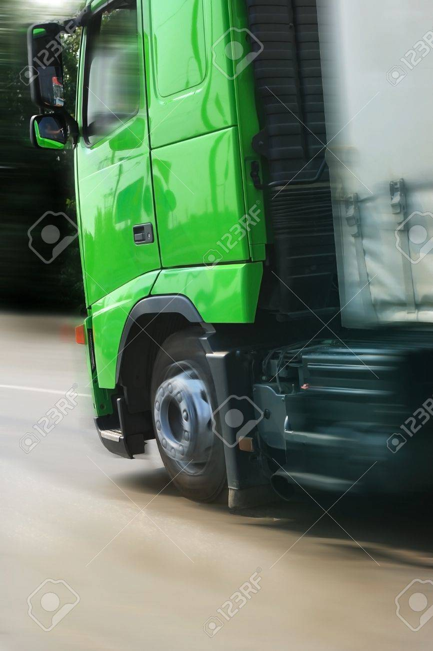 big truck with a green cabin going on highway Stock Photo - 11945224