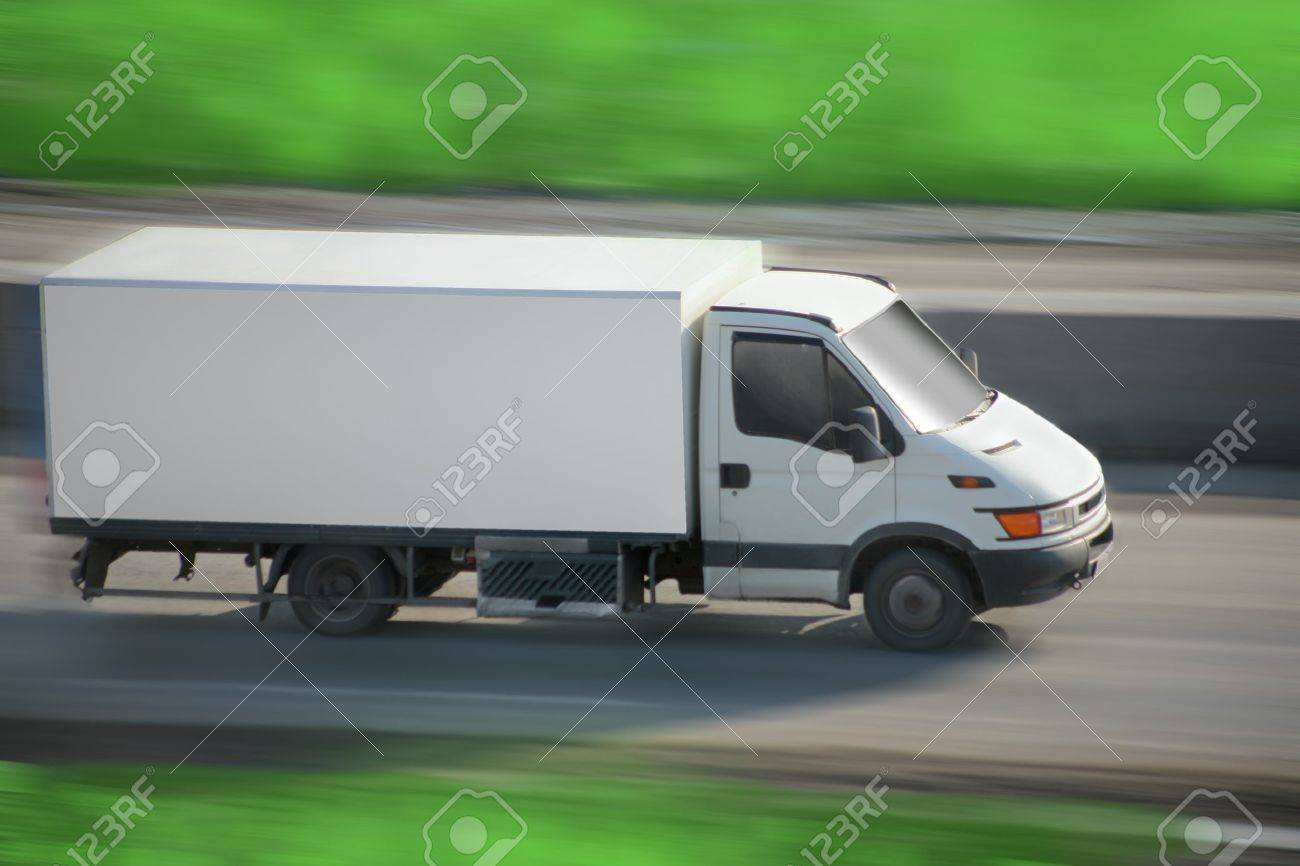truck with  white van moves on road Stock Photo - 13191133