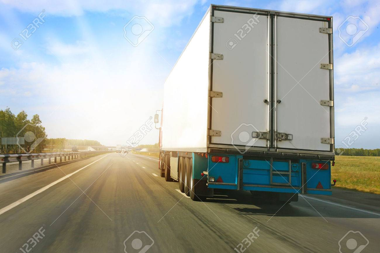 big truck goes on the highway to sunrise stock photo picture and