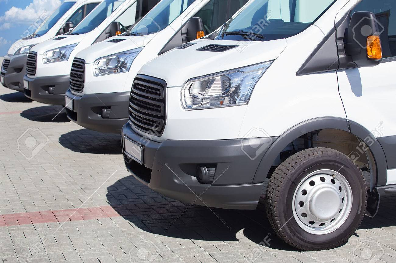 7278699501 number of new white minibuses and vans outside Stock Photo - 57489887