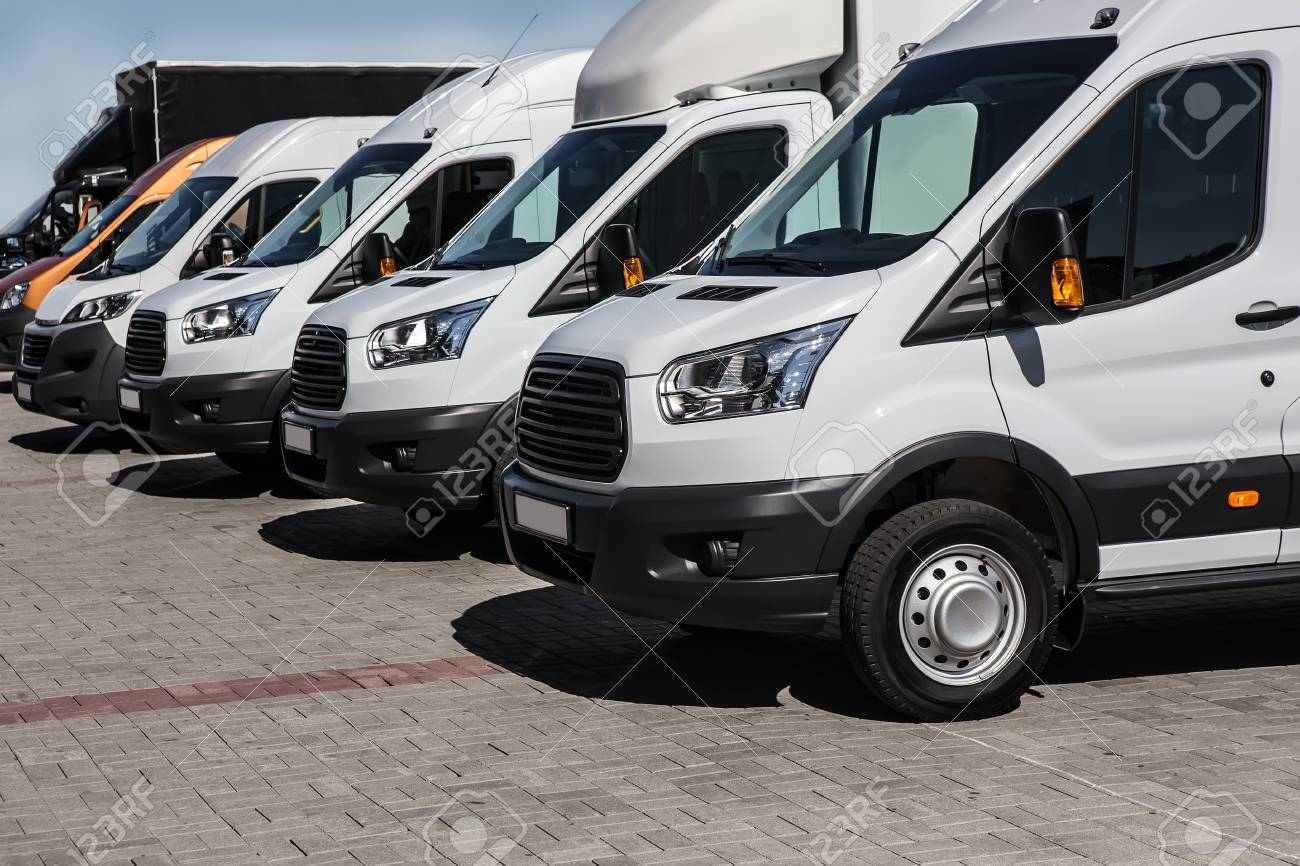 d9fc2d4fb9 number of new white minibuses and vans outside Stock Photo - 92217708