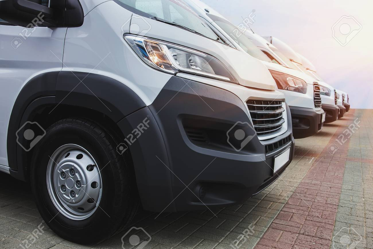99e813c301 number of new white minibuses and vans outside Stock Photo - 102404357