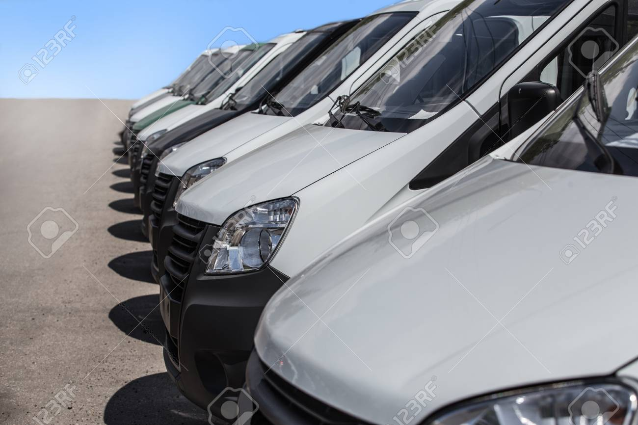 fe509288cc number of new white minibuses and vans outside Stock Photo - 103284974