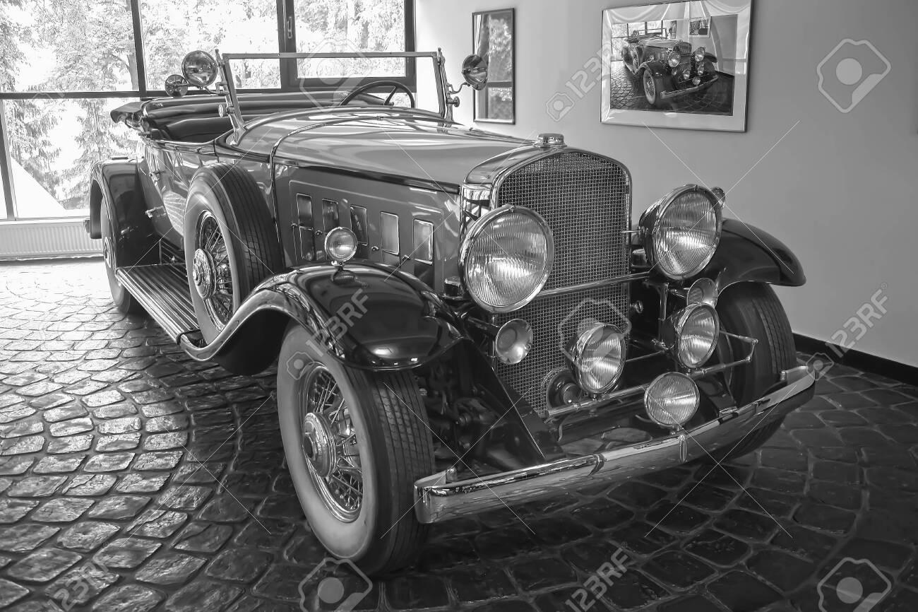beautiful ancient car in garage near window - 120611785