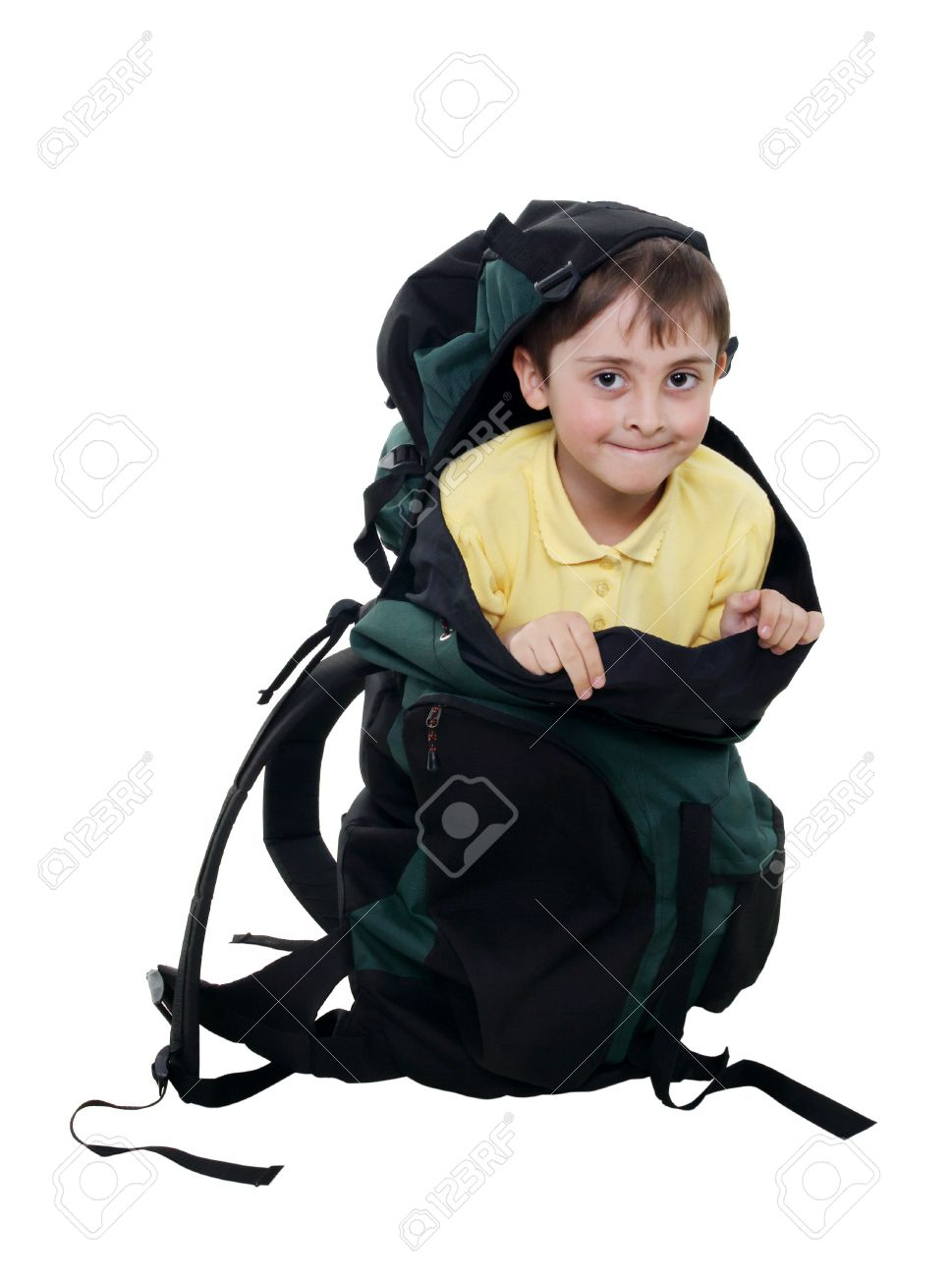small boy in a big tourist backpack on a white background. (isolated) Stock 8de0e8595d228