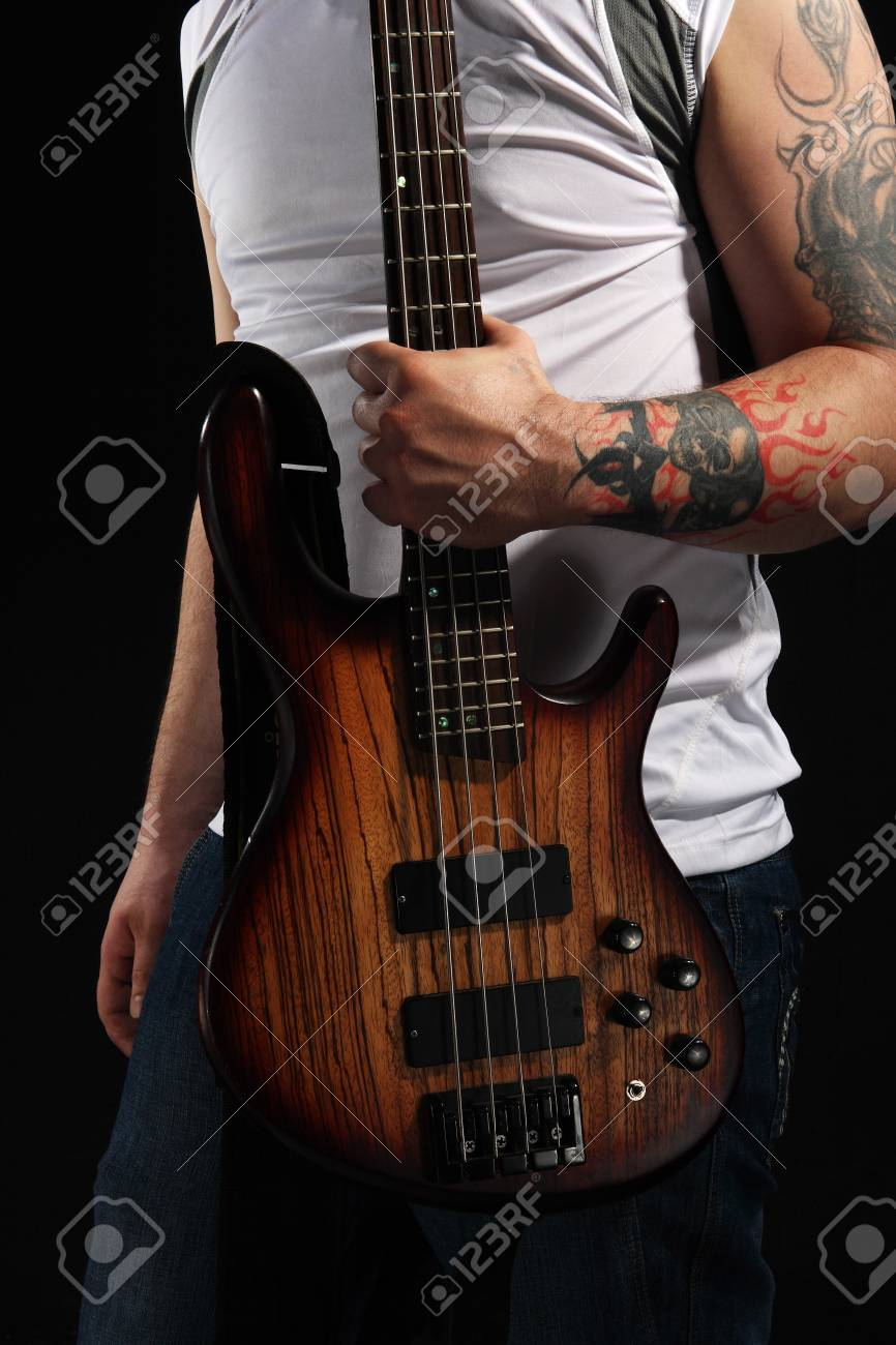 Man playing an electrical guitar on the black background Stock Photo - 7275012