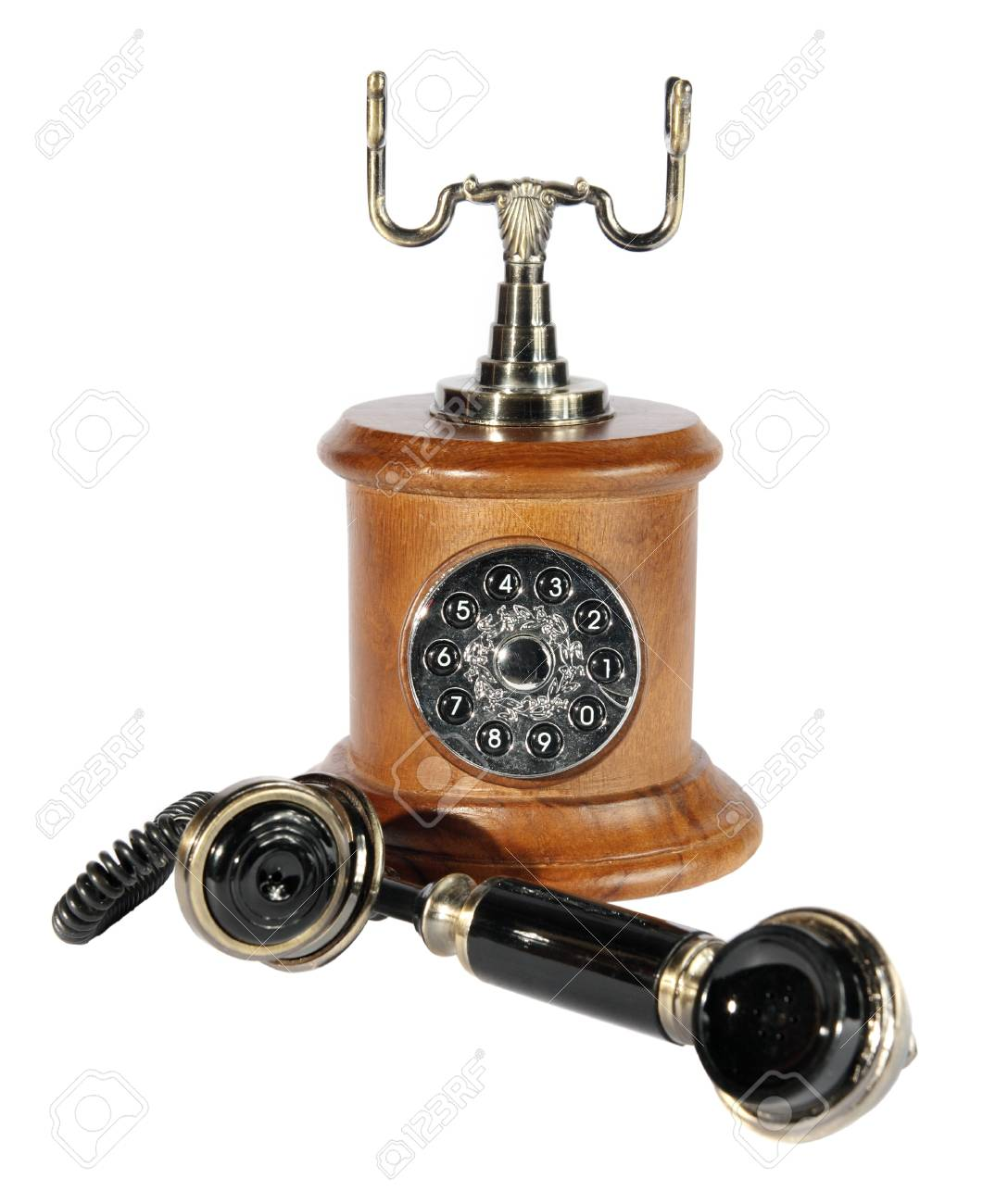 Old phone from a wood and metal on the white background. (isolated) Stock Photo - 8791112